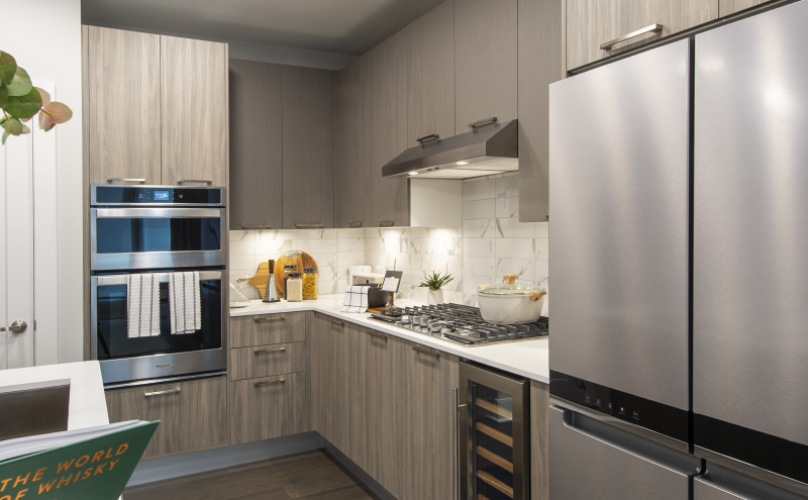 Kitchen with sleek cabinets and appliances