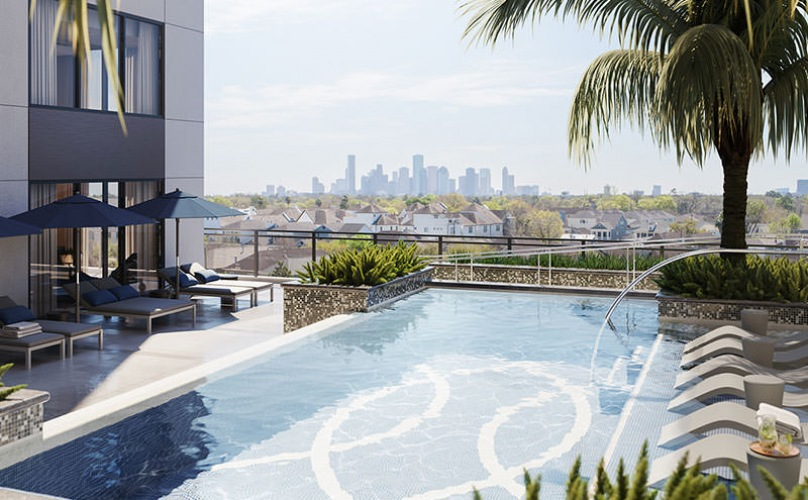 Sparkling blue swimming pool with a view of downtown Houston