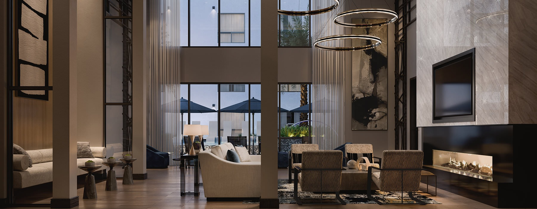luxurious lobby with high ceilings, stylized lighting and seating in front of fireplace