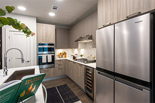 Large open kitchen with stainless steel appliances