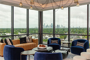 Floor-to-ceiling windows with skyline views